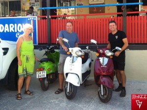 EWIZZ electric scooter owners Bronwen, Lance & Andy charging at Darios